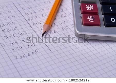 Calculator papier tools business werk tabel Stockfoto © TheProphet