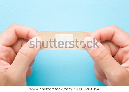 Young girl pointing to a plaster Stock photo © photography33