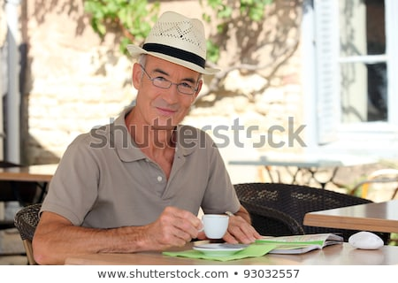 senior citizen sipping his coffee in terrace cafe Stock photo © photography33