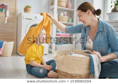 Cute femme ménage blanche fond travail Photo stock © wavebreak_media