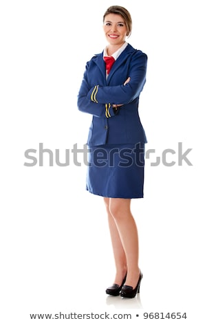 Smiling air hostess standing with arms crossed Stock photo © stockyimages