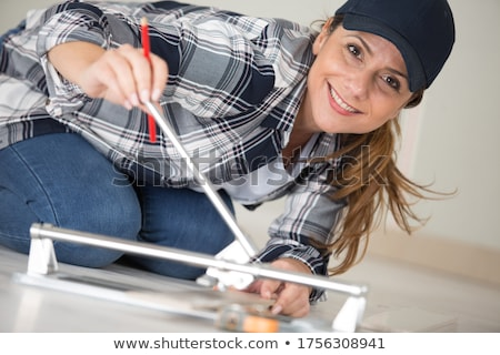 Craftswoman holding a tile Stock photo © photography33