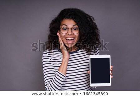 verwonderd · jonge · vrouw · naar · Blauw · blouse - stockfoto © pablocalvog
