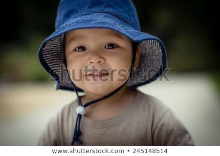 mosolyog · gyönyörű · baba · néz · kamera · kint - stock fotó © dmitrydenisov
