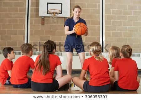 nő · kosárlabda · sportos · stúdiófelvétel · fekete · kéz - stock fotó © highwaystarz