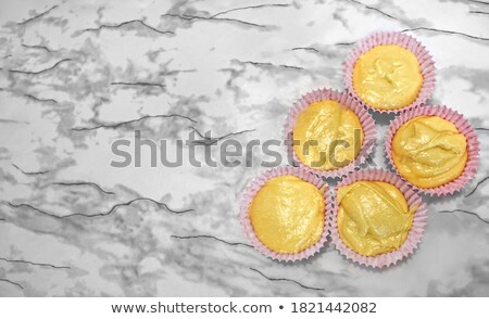 Muffin with strawberry in red holders Stock photo © dariazu