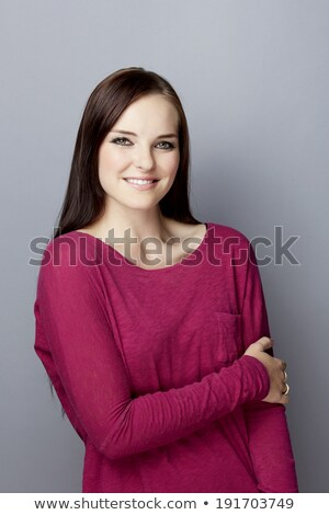 portrait of a young caucasian woman with purple top looks at the camera with sexy look stock photo © ambro