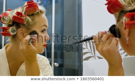 Close up Blond Woman Curling her Eyelashes Stock photo © stryjek