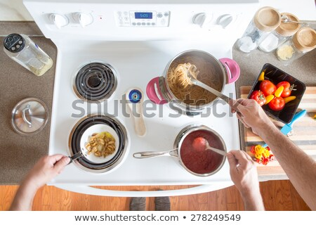 Two men preparing healthy wholewheat spaghetti stock photo © ozgur