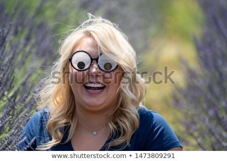 Lány szemüveg nyitott szájjal ül okos lábak keresztbe Stock fotó © feedough