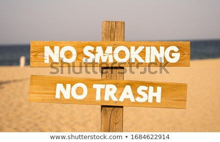 no smoking word on road sign stock photo © fuzzbones0