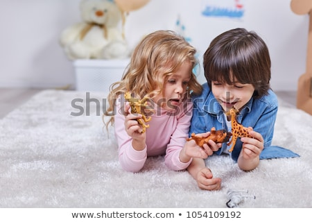 little boy in playroom on toy zebra Stock photo © Paha_L