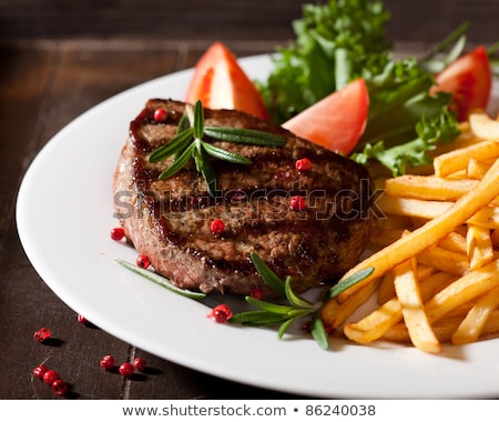 french fries with meat close up stock photo © shutswis