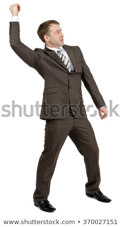 Businessman holding invisible spear Stock photo © cherezoff