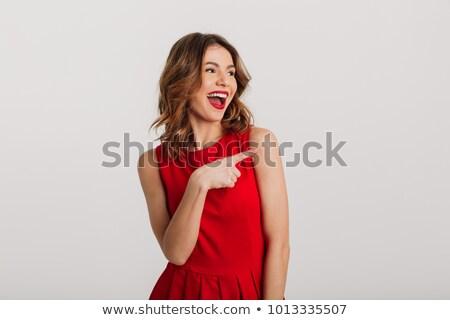 gülümseyen · kadın · işaret · parmak · uzak · yalıtılmış · beyaz - stok fotoğraf © deandrobot