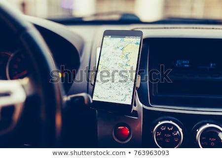 Femminile guida auto GPS navigazione app Foto d'archivio © stevanovicigor