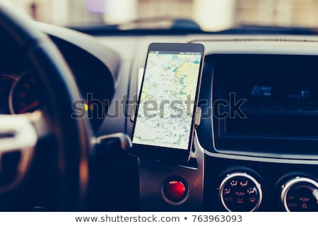 Female driving car and using gps navigation app on smartphone Stock photo © stevanovicigor