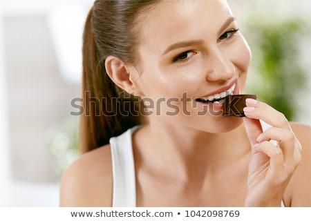 Donna mordere cioccolato isolato Foto d'archivio © sapegina