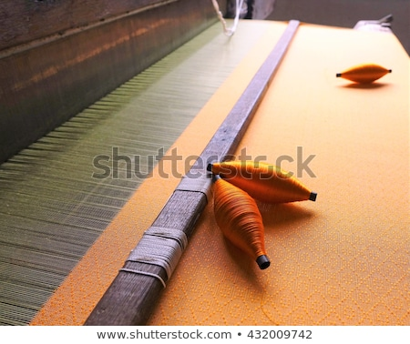 weaving on a wooden loom stock photo © phantom1311