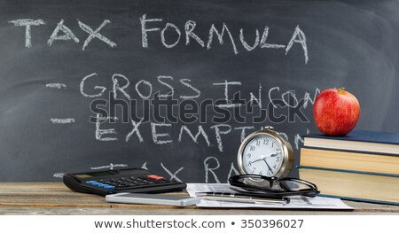 Desktop and chalkboard for working on income taxes  Stock photo © tab62