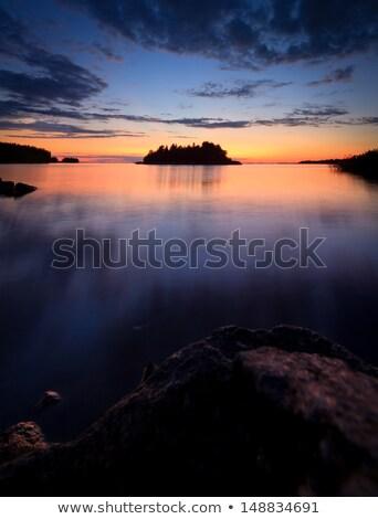 Hermosa vibrante puesta de sol nubes paisaje Finlandia Foto stock © Juhku