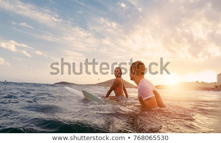 Foto stock: smiling young woman with surfboard on beach