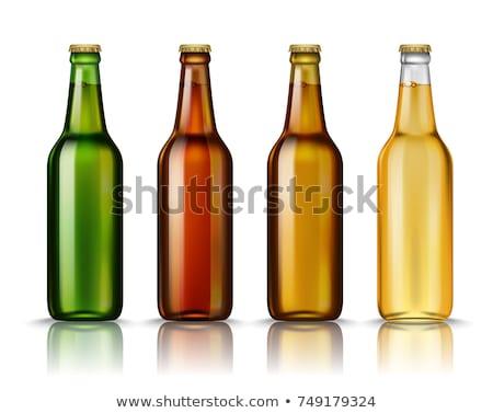 Brown glass beer bottle with yellow cap on white Stock fotó © DenisMArt