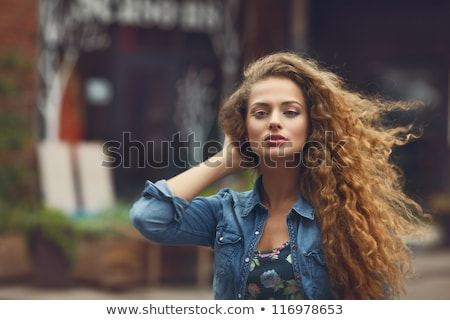 beautiful girl with curly hairdo Stock photo © svetography