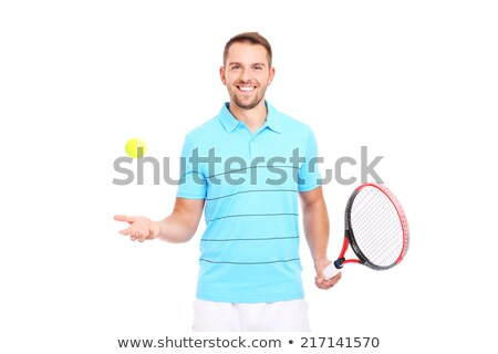 Happy young sportsman holding tennis ball and racket. Stock photo © deandrobot
