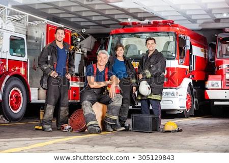 young caucasian happy firefighter stock photo © rastudio