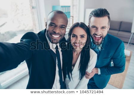 Picture of young trio of office workers standing  Stock photo © Traimak