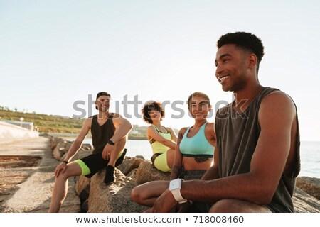 quatre · personnes · séance · plage · ciel · sable · liberté - photo stock © deandrobot