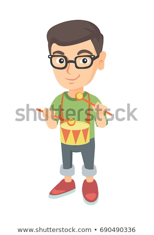 cheerful caucasian boy in glasses playing the drum stock photo © rastudio