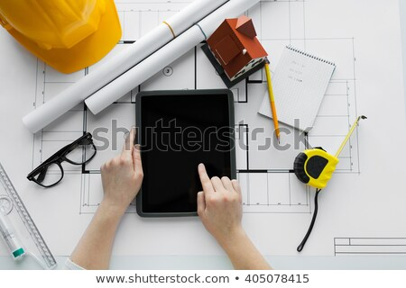close up of living house model and tablet pc stock photo © dolgachov