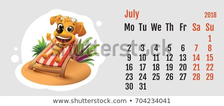 2018 year of yellow dog on chinese calendar fun dog lies in deck chair calendar grid month july stock photo © orensila