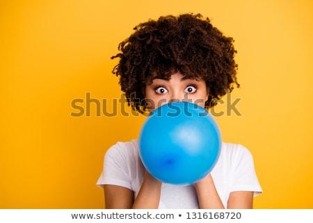 Afro girl blowing bubble gum balloon. Stock photo © NeonShot