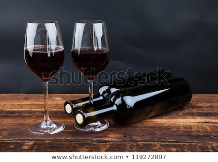Bottle of homemade red wine and glass with cork Stock photo © DenisMArt