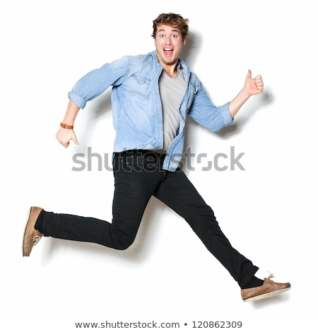 Full length portrait of a happy energetic man Stock photo © deandrobot