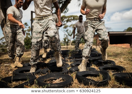 Determined military soldiers exercising with tyre Stock photo © wavebreak_media