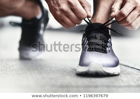 Stock photo: Close up of a man tying tying shoelace