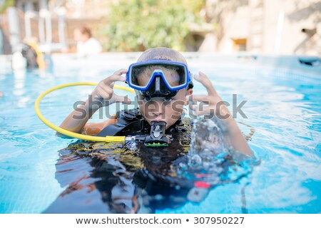 Stock photo: A kid learn to diving