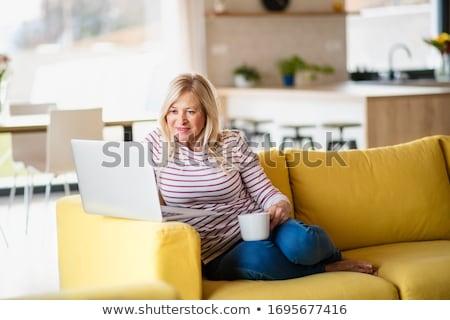 bela · mulher · sofá · vidro · vinho · mão · festa - foto stock © dolgachov