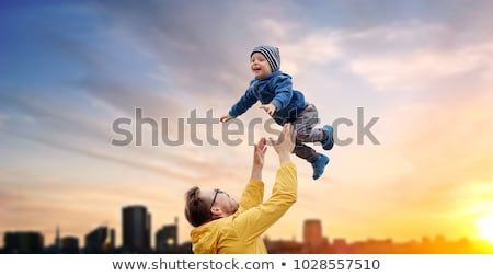 happy family over sunset in tallinn city stock photo © dolgachov