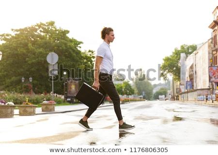 вид сбоку деловой человек портфель портативного компьютера Сток-фото © deandrobot