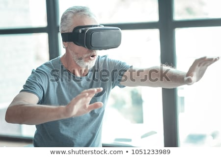 Empty room with a man in vr glasses Stock fotó © ra2studio