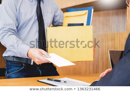 Hand of a businessman hands over a resignation letter final remu Foto stock © snowing