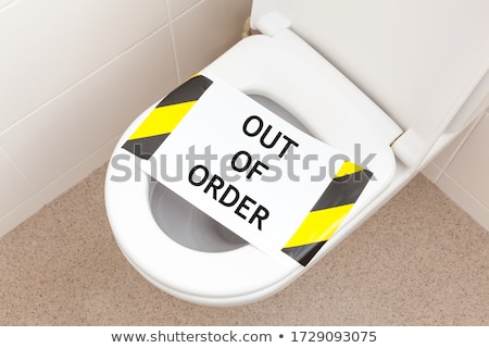 Out Of Order Text On Toilet Bowl Stock photo © AndreyPopov