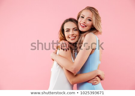 happy friends hugging over beach background Stock photo © dolgachov