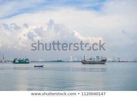 Stok fotoğraf: Cargo Ship And Ferry Near The Port In Penang Malaysia