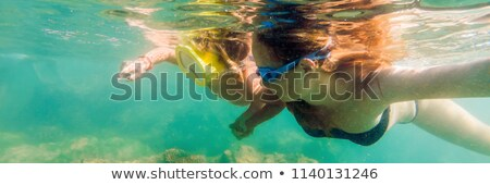 happy mother and son snorkeling on beach BANNER, long format Stock photo © galitskaya